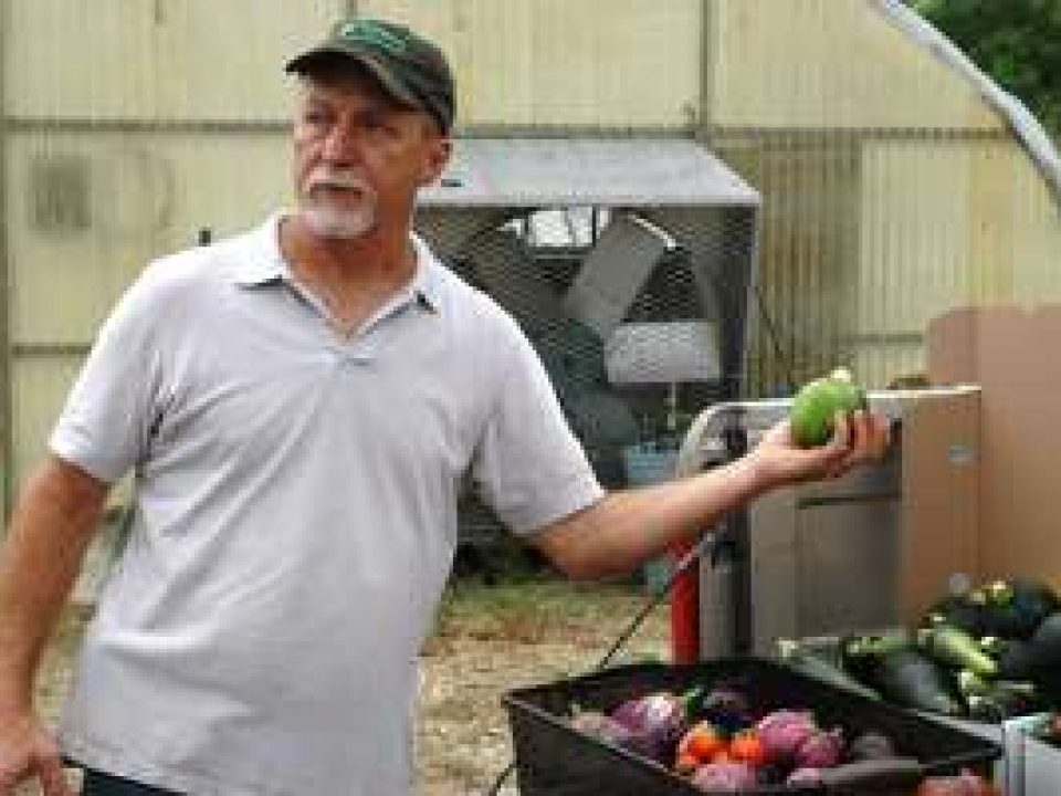 Farmer showing his vegetables AgriLife Today Flickr